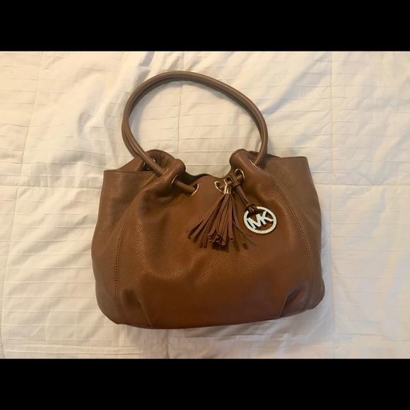 7987500d3e32 Michael Kors Bags | Tassle Ring Tote | Poshmark